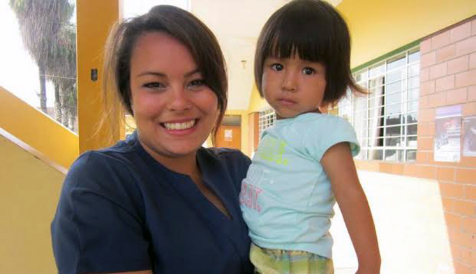 Derleth's daughter, Goisi, with a child at one of the clinics in Peru.