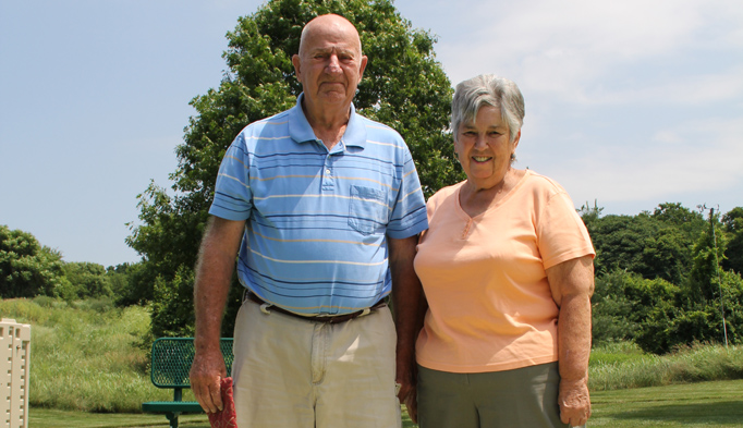 "Bob and Judy House stand in the recreational area on the Robinwood Campus of Diakon Senior Living – Hagerstown. They say they are enjoying life at Robinwood so much they should have moved ""a long time ago."""