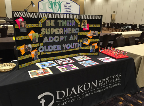Table top display encouraging PA resource families to consider the adoption of older, special needs youth and children.