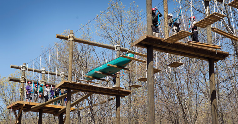 Participants in many Diakon Wilderness Center and Diakon Youth Services programs take part in challenge activities on the high-ropes course at the Boiling Springs, Pa., center.