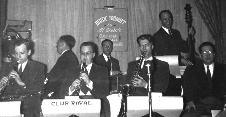 Al Gruber's orchestra in concert; Gruber is in the rear, playing the drums.