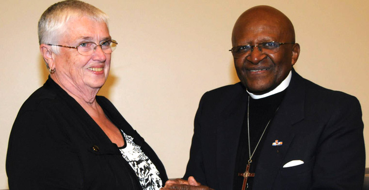 Patricia Trexler at 2012 Leading Age conference with Bishop Emeritus Edmond Tutu.
