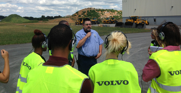 Students from the Diakon Wilderness Center' Center Point Day Program listen to a senior staff member from Volvo CE discuss careers with the company.