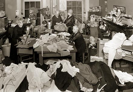 The Inner Mission Society Auxiliary prepares clothing for the needy.