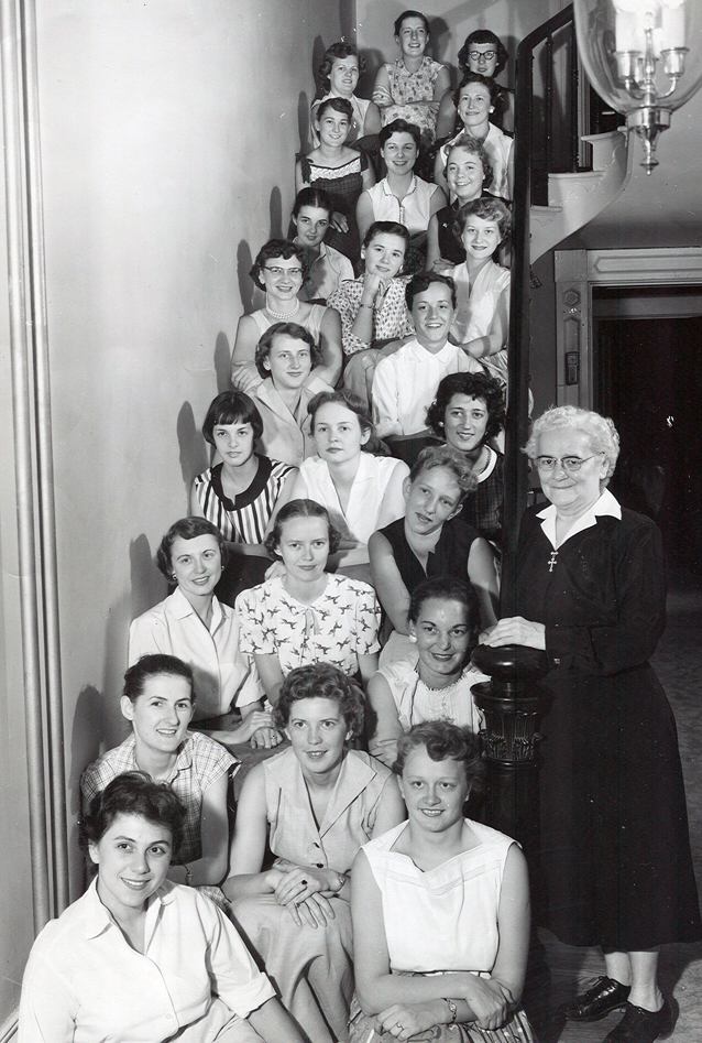 Sister Zora Heckart, right, with just some of the 800 young women who lived at the Lutheran Hospice in Baltimore during her 40 years as housemother. Mary Sullins is pictured third from the bottom on the left. Geraldine Mullinix is second from the bottom on the right.