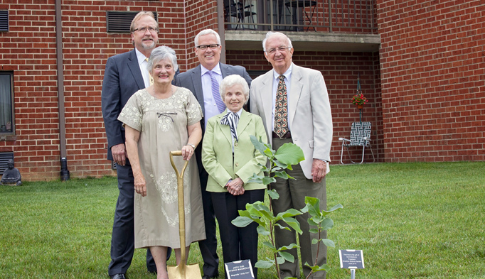 Having planted one of the trees donated by the Brooklyn Botanical Garden, dedication participants pose for a photo. From left to right are, rear, Mark Pile, Scot Medbury, and the Rev. Dr. Paul Buehrle; front, Frances Jennings and Dr. Marion Kayhart.