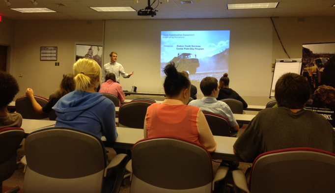 Chris Price with Volvo CE discusses careers in the company's field with students in Diakon's Center Point Day Program.