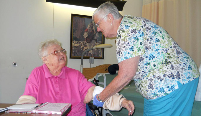 Patricia Trexler, right, cares for The Lutheran Home at Topton resident Yvonne Lewis.