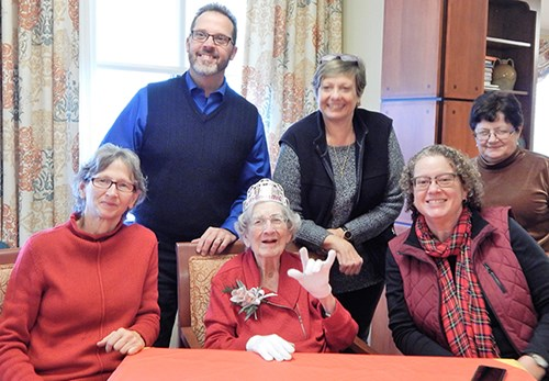 A group of Harriet MacDonald's friends, who also are deaf, visit with her during her 100th birthday party.