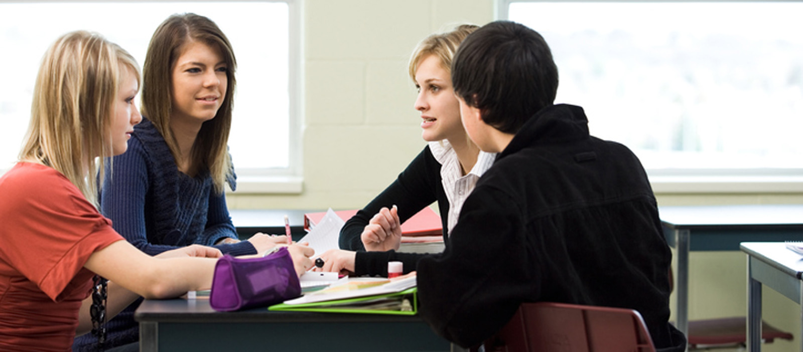 Teenagers holding conversation during a Diakon Crossroads Support group meeting.