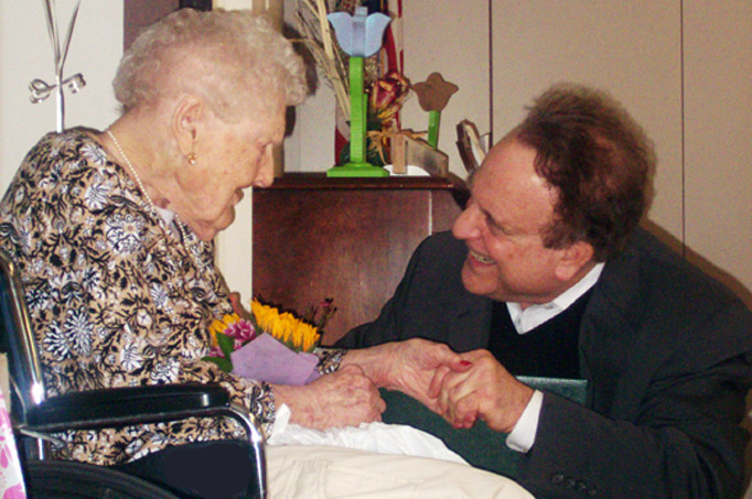 Sophie Voynar is greeted on her 108th birthday by state Sen. Andrew Dinniman.