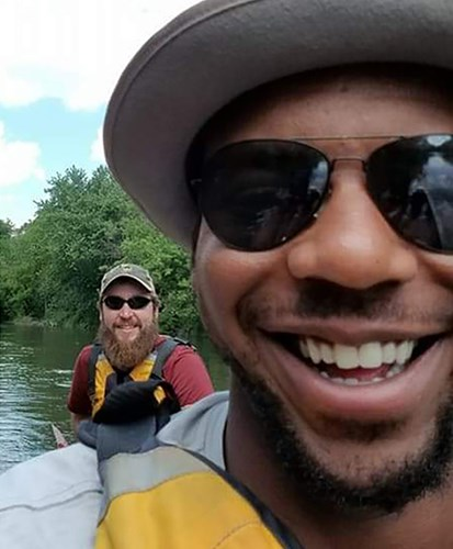 Anthony Stukes, right, during a Diakon Youth Services canoe trip